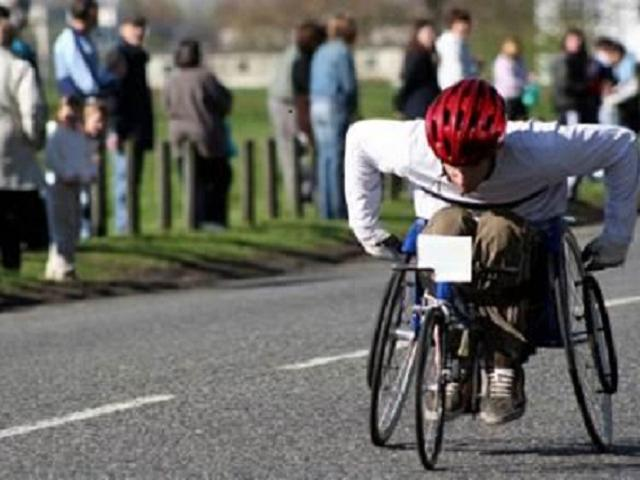 Person racing in wheelchair
